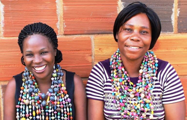 Uganda Kampala girls make paper bead jewelry necklaces