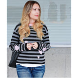 This graphic striped pullover features contrasting pink hearts artfully tossed. 100% soft cotton is in a fine gauge jacquard, suitable for all seasons. Details include jewel neck, long sleeves, and rib trims. Choose: Black/Off-White Stripe has bright pink hearts and neck trim. or Black/Grey Heather Stripe has pale pink hearts and neck trim. 100% softest cotton Rib trims Fine gauge jacquard Machine wash cold, lay flat to dry. Hearts and Stripes sweater