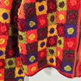 Originally in Saks Fifth Avenue, retailing for $180. Entirely hand crocheted in 55% Ramie/ 45% Cotton (Ramie is a natural fiber - a derivative of Linen) and other mixed yarns such as Chenille.  In spice colors with a brown zipper front closure and a crochet covered ring zipper pull.  Long sleeves, mid hip length.  Roomy fit. Size Small could easily fit size Medium. Crochet squares in front, crochet stripes in back.1990 vintage crochet sweater