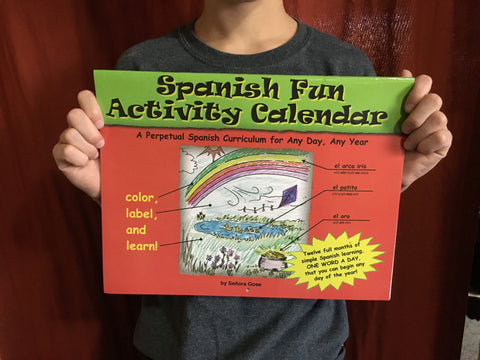Child holding Spanish Fun Activity Calendar by Flip Flop Spanish