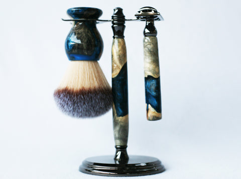 Buckeye Burl Shave Set with Blue and Silver Resin safety razor, 26mm lather brush and a matching shave stand.