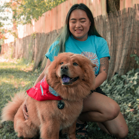 chow chow with girl wearing bandana