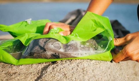 portable washing bag for keeping clothes clean while camping