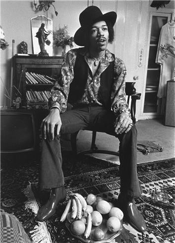 Jimi Hendrix at his home in Brooke St London, 1969 by Barrie Wentzell