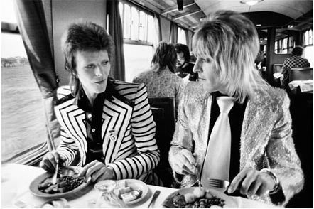 David Bowie & Mick Ronson, Lunch on the Train to Aberdeen 1973 by Mick Rock