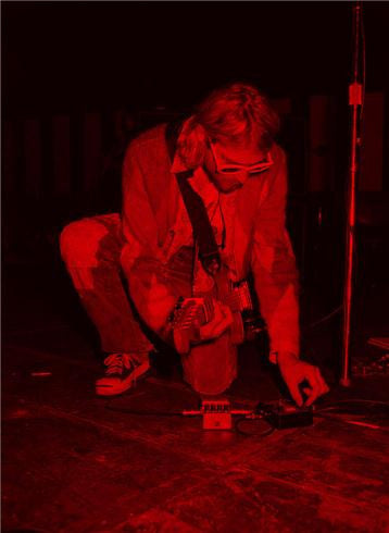 Kurt Cobain, Kneeling Red, 1993 by Jesse Frohman
