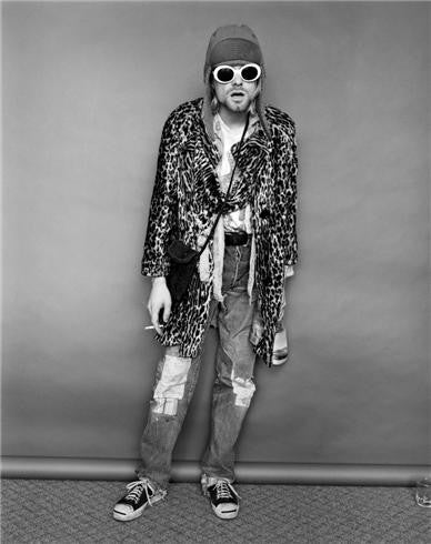 Kurt Cobain standing with Evian bottle, 1993 by Jesse Frohman