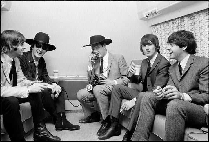 The Beatles with manager Brian Epstein, 1964 by Curt Gunther