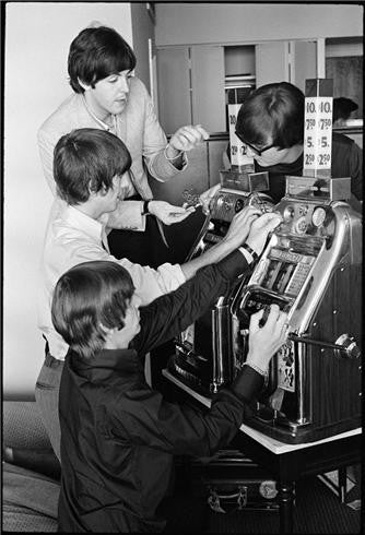 The Beatles with slot machine, 1964 by Curt Gunther