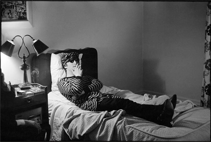 John Lennon in bed, 1964 by Curt Gunther