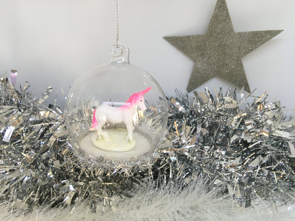 Unicorn bauble with tinsel around the bottom
