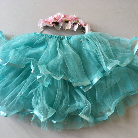 Layered sparkling tutu with flower garland