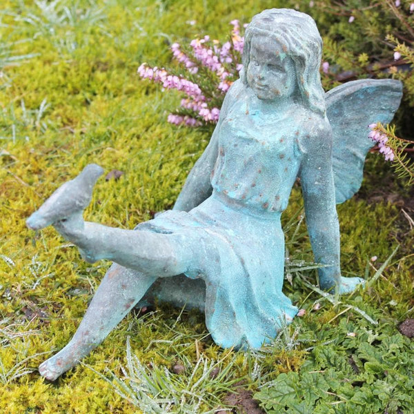 Rustic Cast Iron Fairy Statue at the Farthing