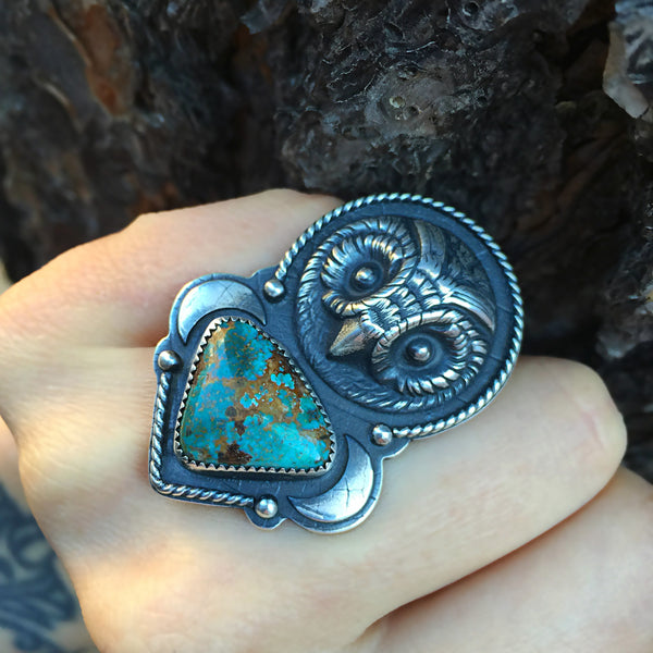 The Seer Ring is handcrafted from natural Blue Gem Mine turquoise and sterling silver.  It features an owl face cast from an antique button.  The ring was handcrafted by metalsmith Nikki Leigh of Osa Metal Studio.
