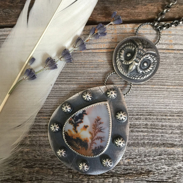 The Seer Necklace is handcrafted from dendritic agate and sterling silver with a casting of a real antique owl button.  The necklace is made by Nikki Leigh of Osa Metal Studio.