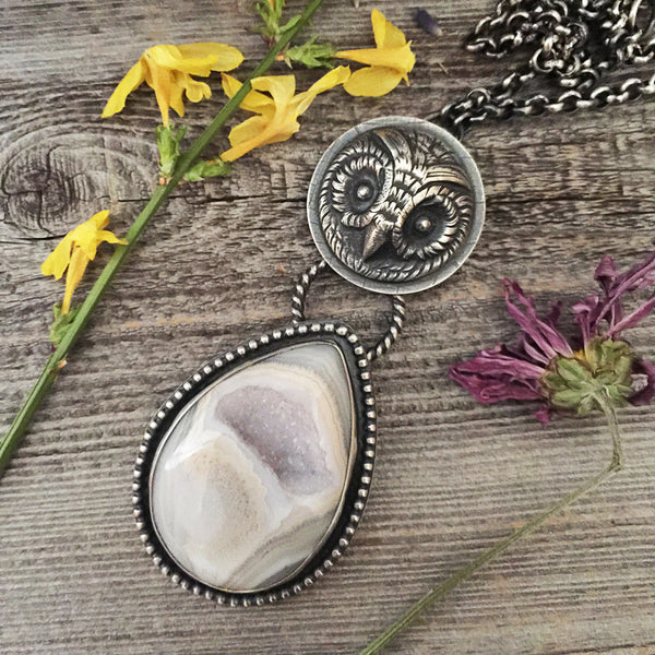 The Seer Necklace is handcrafted from sterling silver and lavender druzy agate stone.  It was handmade by Nikki Leigh of Osa Metal Studio who specializes in boho, festival style, heirloom jewelry.