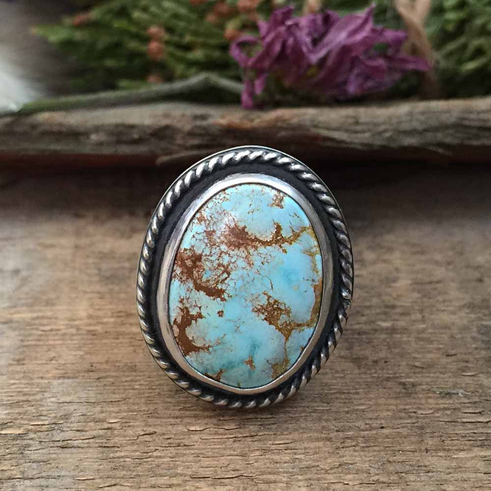 The Moon Amulet ring is handcrafted from heavy sterling silver and features a light blue, natural turquoise stone from the Paradise Mine.  The ring is handmade by Nikki Leigh of Osa Metal Studio.