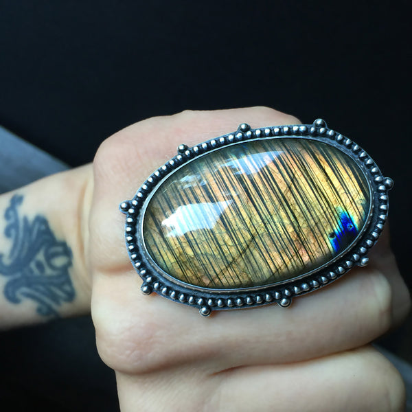 The Night Sky ring is an orange labradorite and sterling silver statement ring handcrafted by silversmith Nikki Leigh of Osa Metal Studio.