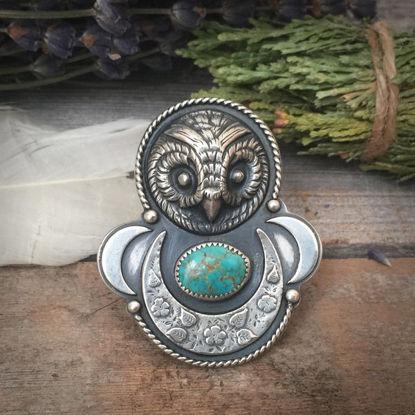 The Stone Keeper Ring is handcrafted from sterling silver and natural Royston Turquoise.  It features castings of antique owl and moon buttons.  It was handmade by Nikki Leigh of Osa Metal Studio.