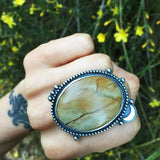 Handcrafted fossilized wood and sterling silver boho statement ring with a silver moon trim.  Nikki Leigh of Osa Metal Studio specializes in handmade, boho jewelry.