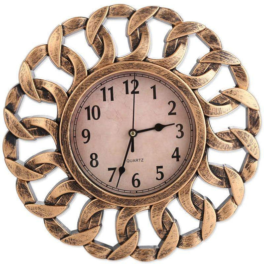 Circular wall clock with a ring chain design