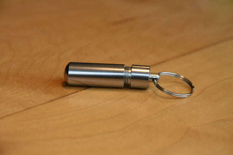 Small capsule on a keyring for keeping emergency cash when travelling