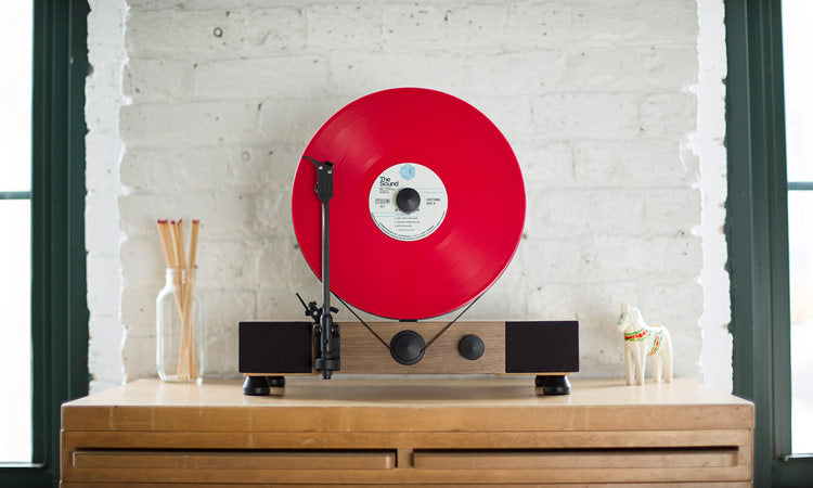Floating Record Vertical Turntable – Vertical Record Player with Built-in Speakers | Product Feature – Walnut, Scene-View, Red Vinyl