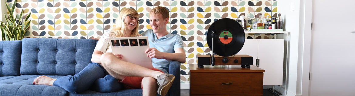 Floating Record Vertical Turntable – Vertical Record Player with Built-in Speakers | Contact Page - Living Room, Couple Smiling, Vinyl