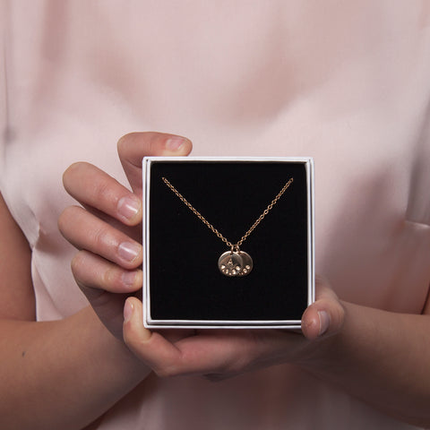 gold date and initial necklace
