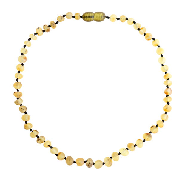 petit stellou baby amber necklace sand light