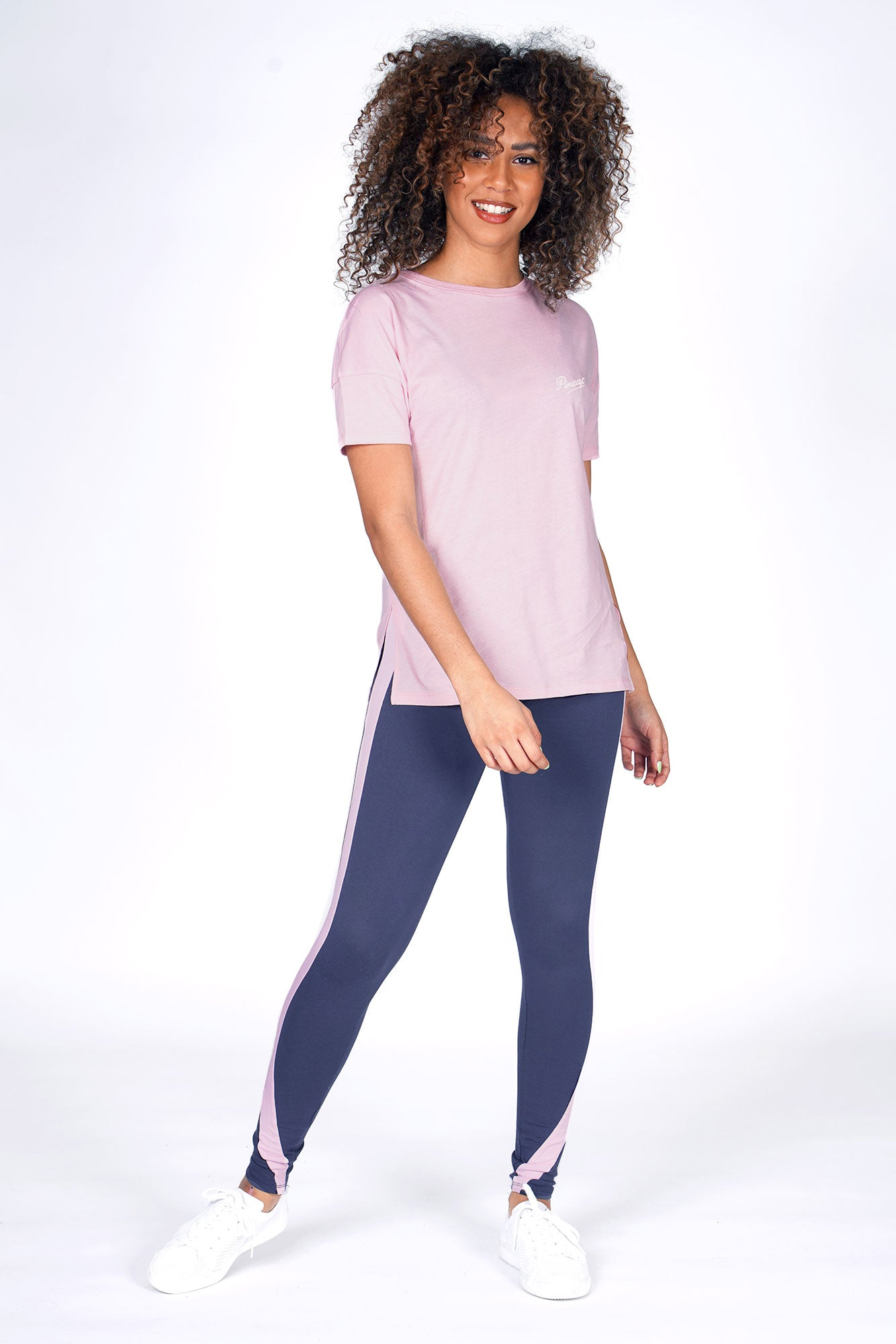 Woman wearing Charcoal Racer Stripe Leggings and Coral Side Slit T-Shirt