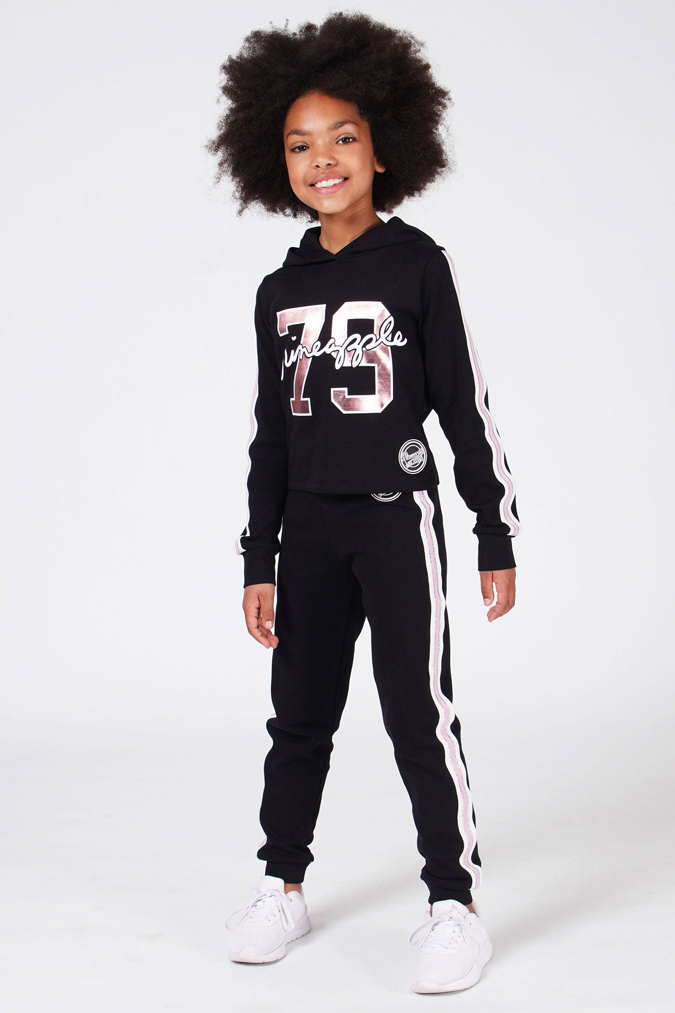 Girl wearing black Stripe Badge Joggers with Black and Pink Stripe 79 Hoodie
