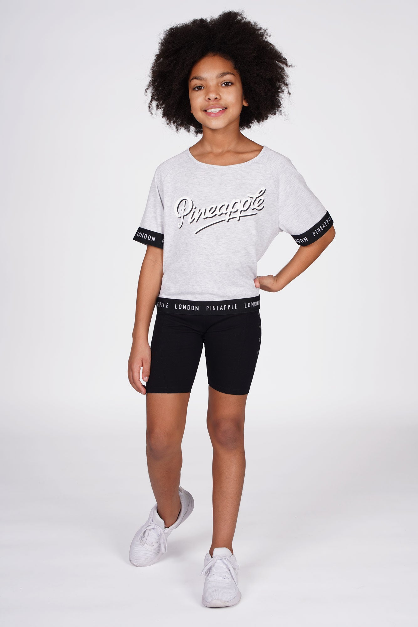 Girl wearing Heart Stud Black Cycling Shorts with grey  jacquard t-shirt