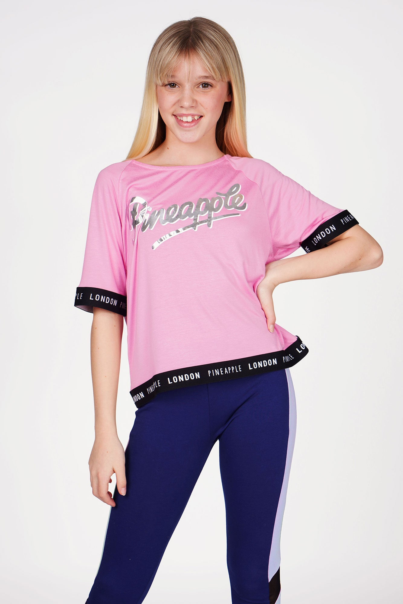 Girl wearing Pineapple Pink Jacquard T-Shirt with Navy Blue Piping Leggings