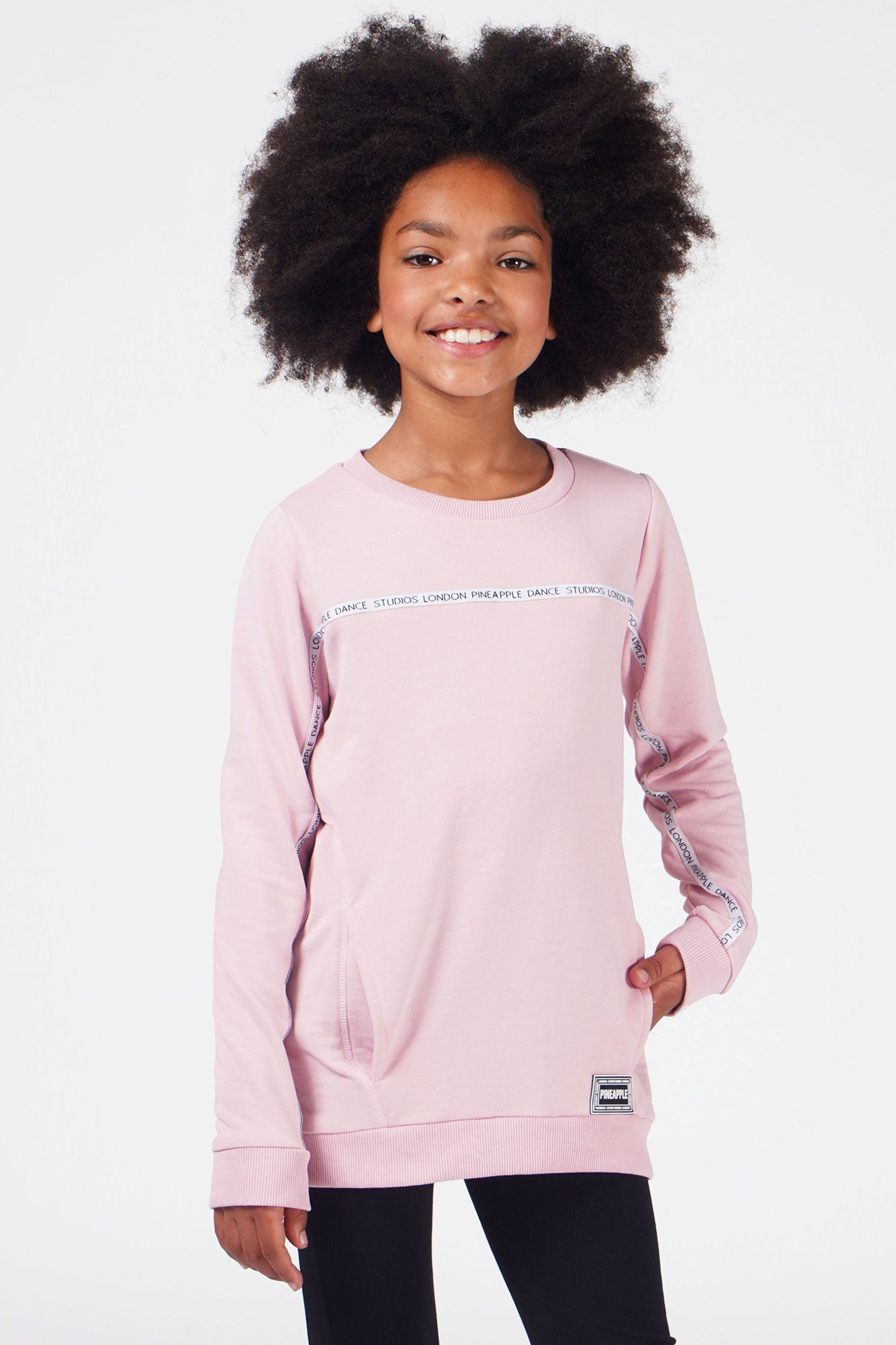 Girl wearing Pink Pineapple Tape Monster Sweater