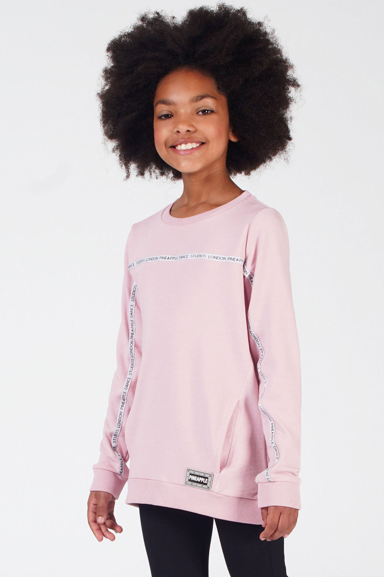 Girl wearing Pink Tape Monster Sweater