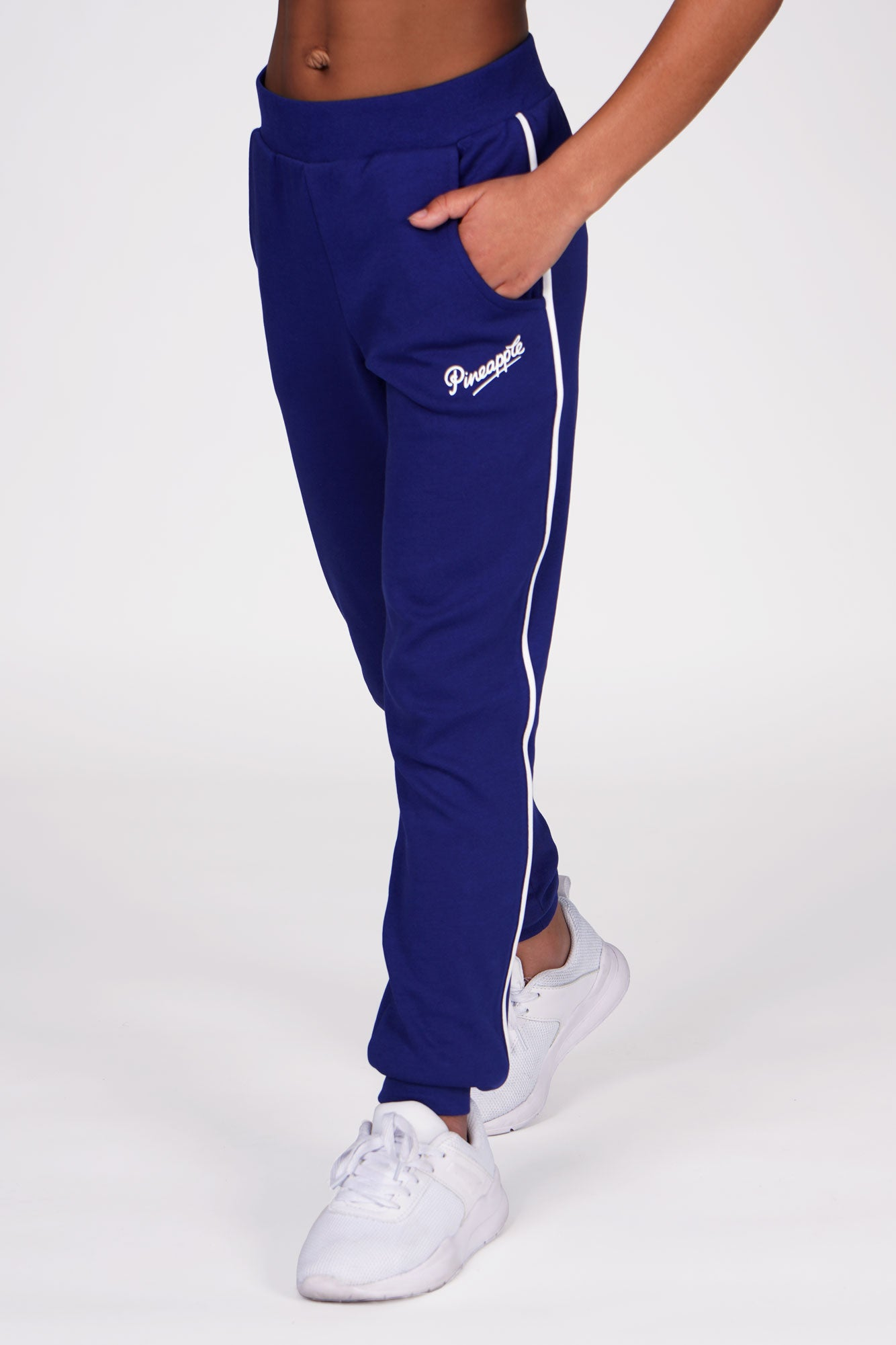 Girl wearing Pineapple Navy Pocket Joggers with white stripes