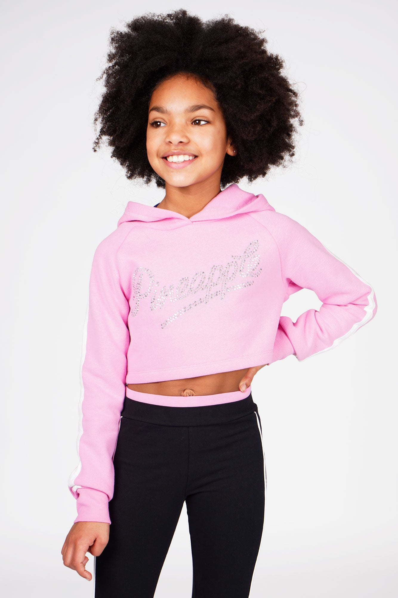 Girl wearing Pineapple Pink Stud Logo Crop Hoodie with Black Double Band Mesh Legging, cropped front view