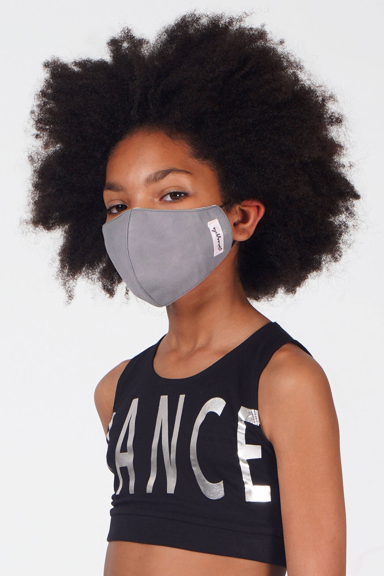 Girl wearing Pineapple grey fabric face mask