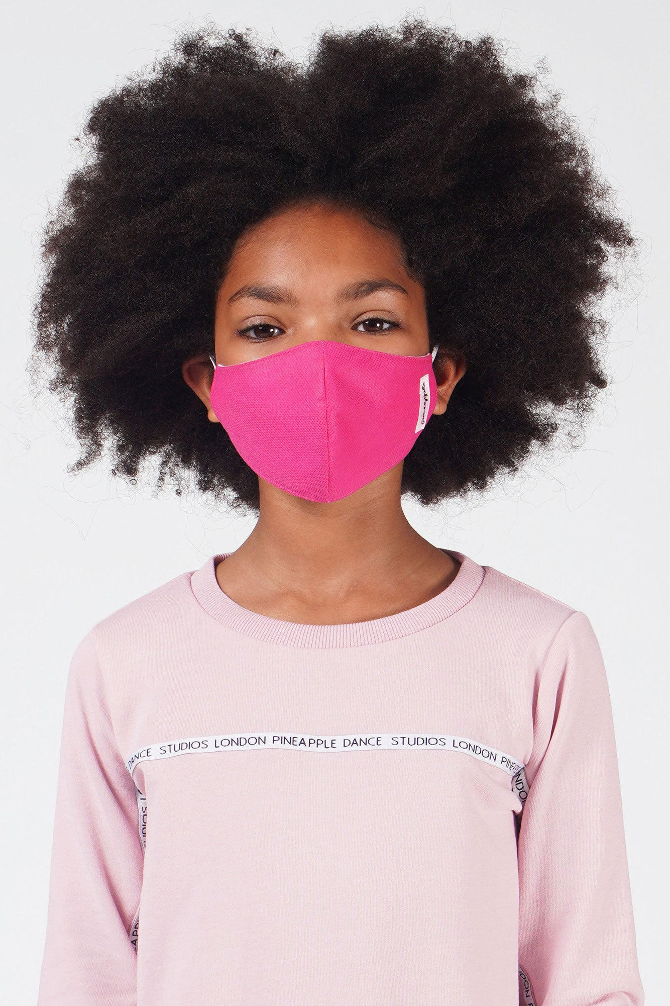 Girl wearing Pineapple kids' hot pink fabric mask