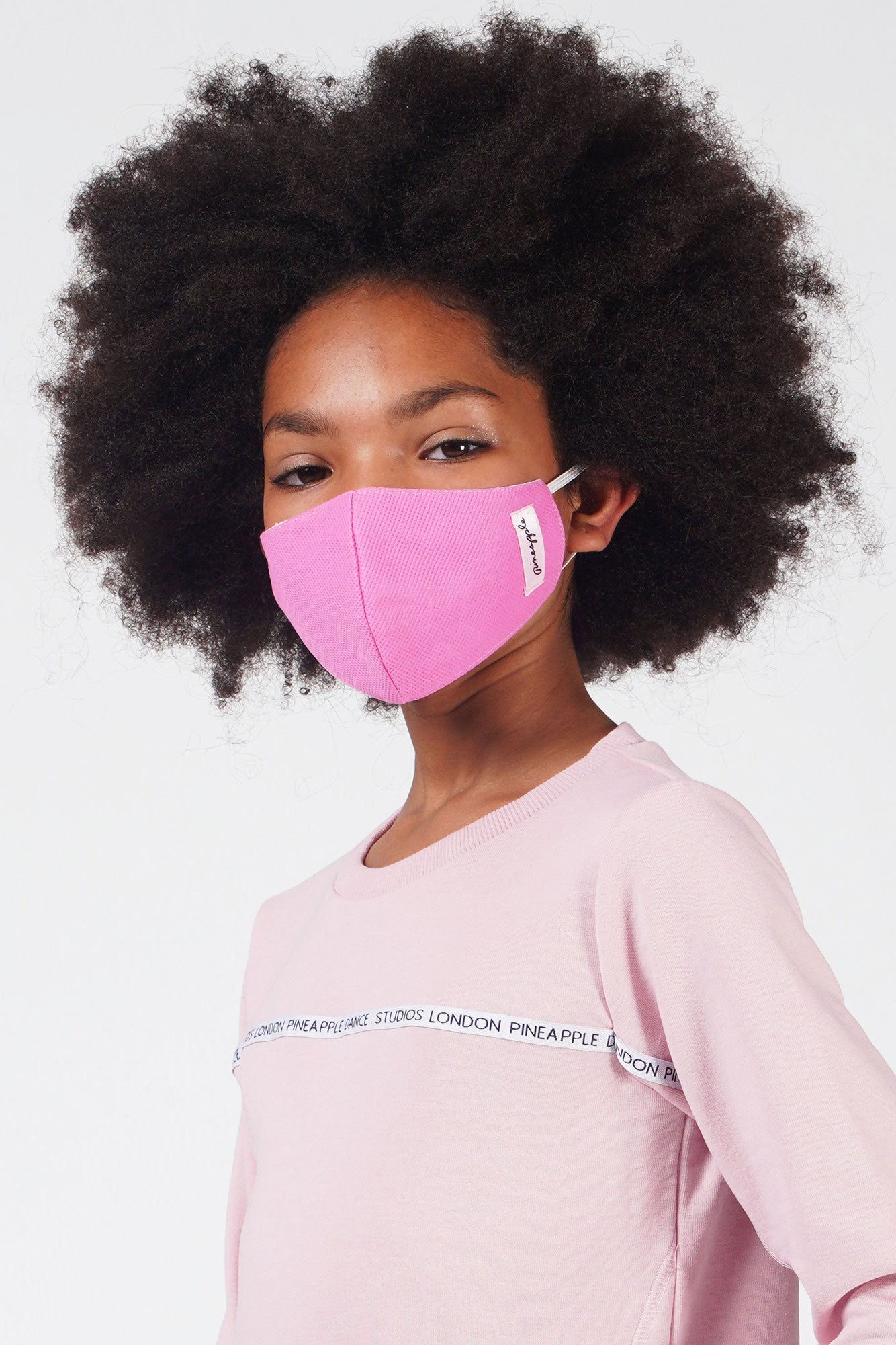 Girl wearing Pineapple light pink fabric face mask