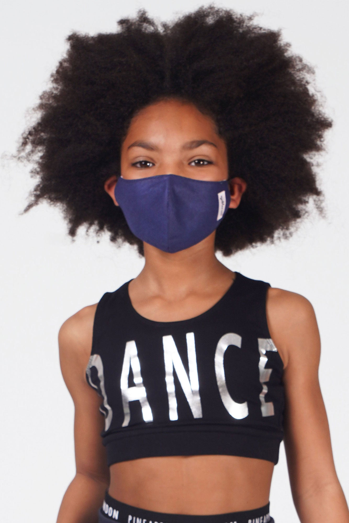 Girl wearing Pineapple navy fabric face mask