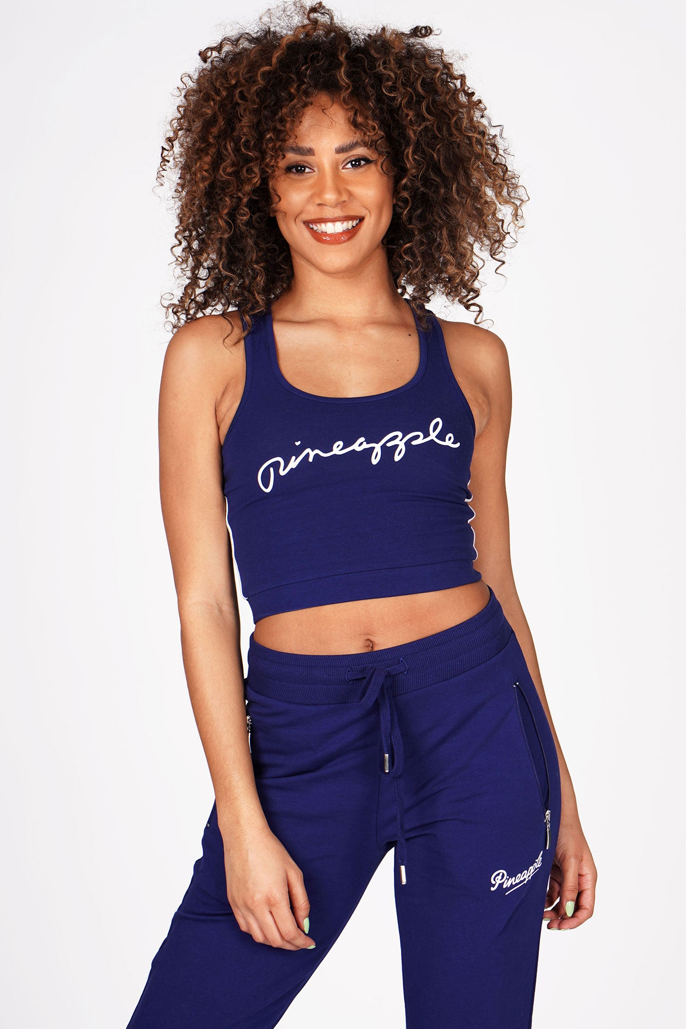 Woman wearing Pineapple Navy Racer Midi Crop Top