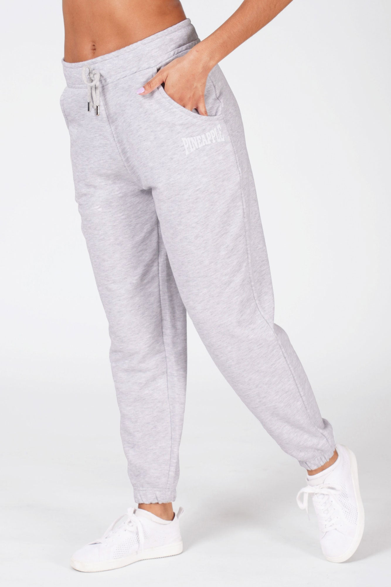 Woman wearing grey Pineapple oversized pocket joggers.