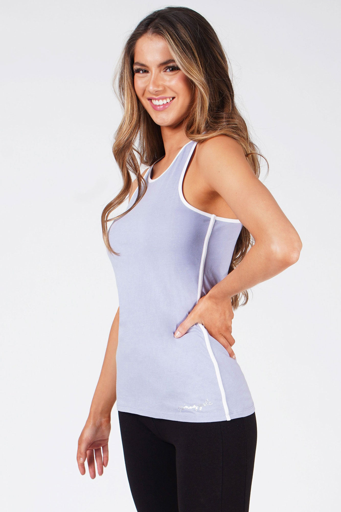 Woman wearing Pineapple Light Blue Stripe Racer Vest