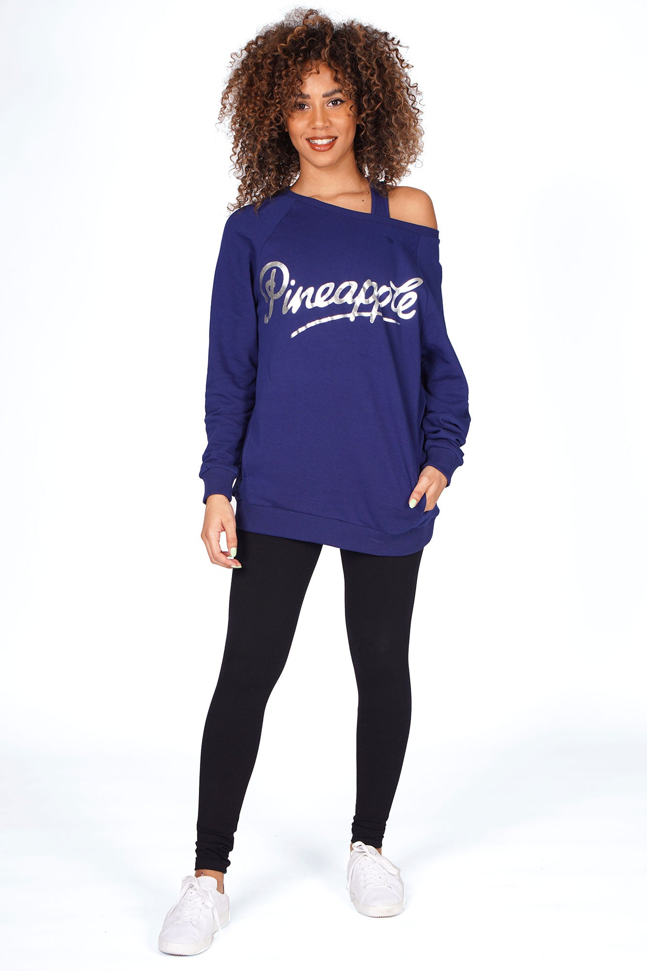 Woman waring Navy Blue Pineapple Monster Sweater with Black Leggings