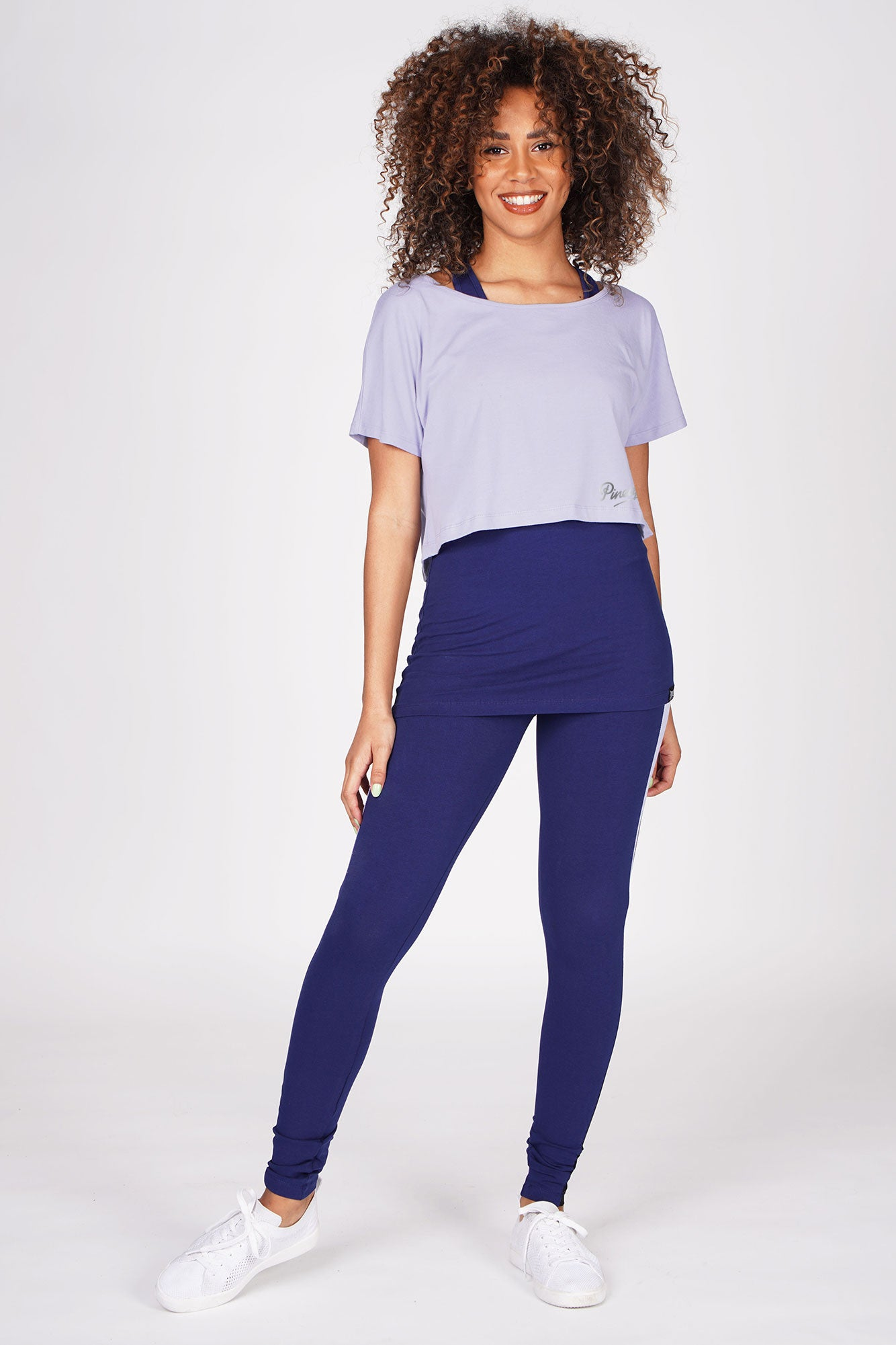 Woman wearing Navy V Mesh Panel Leggings and blue double layer top set
