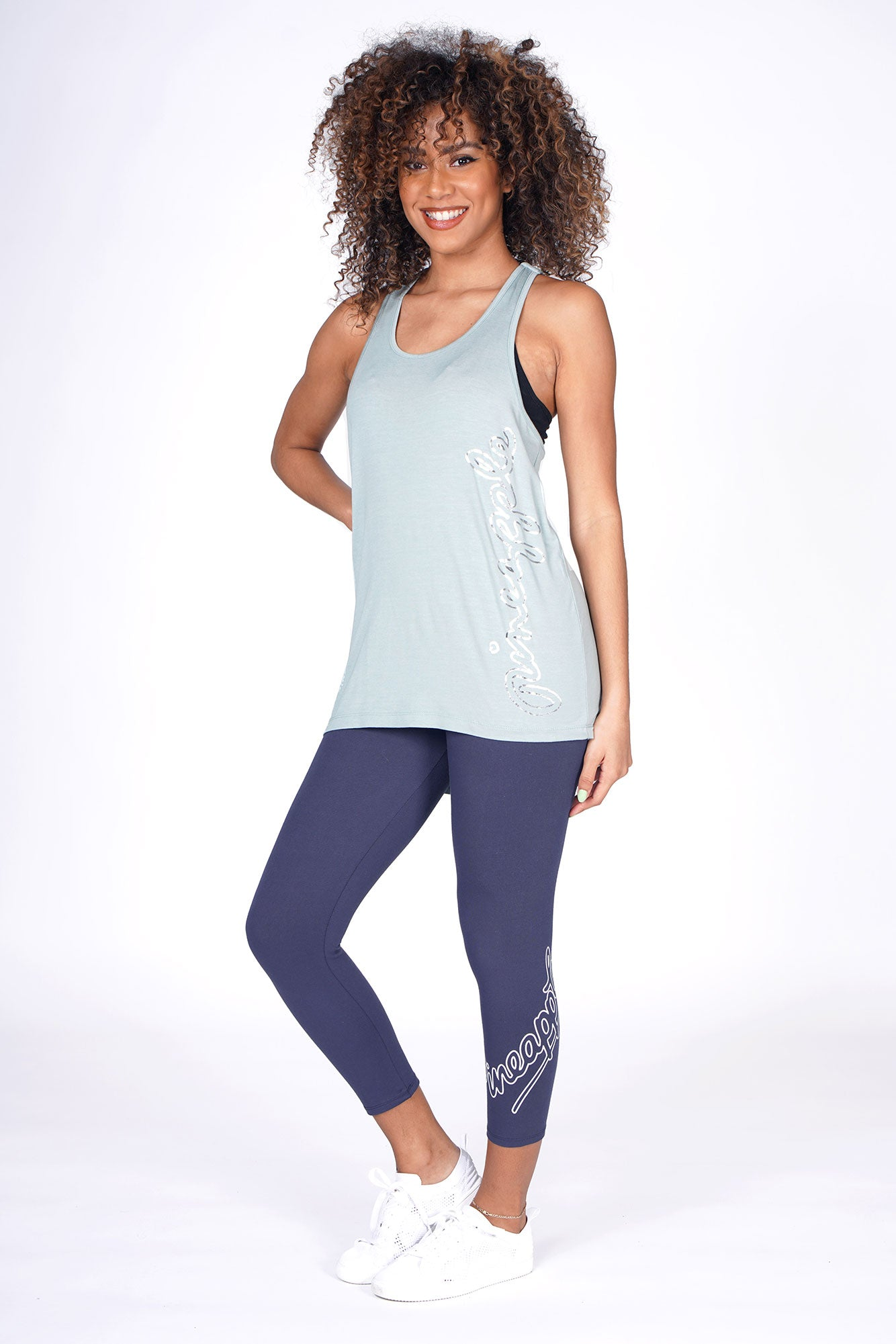 Woman wearing Sage Jacquard Vest with charcoal leggings