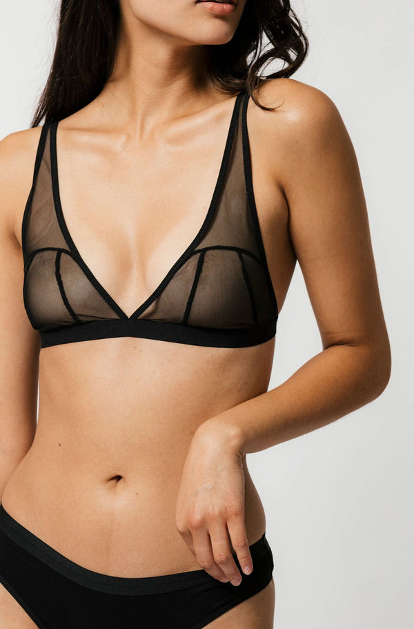 Model posing mesh sheer black beckett bra and black thong
