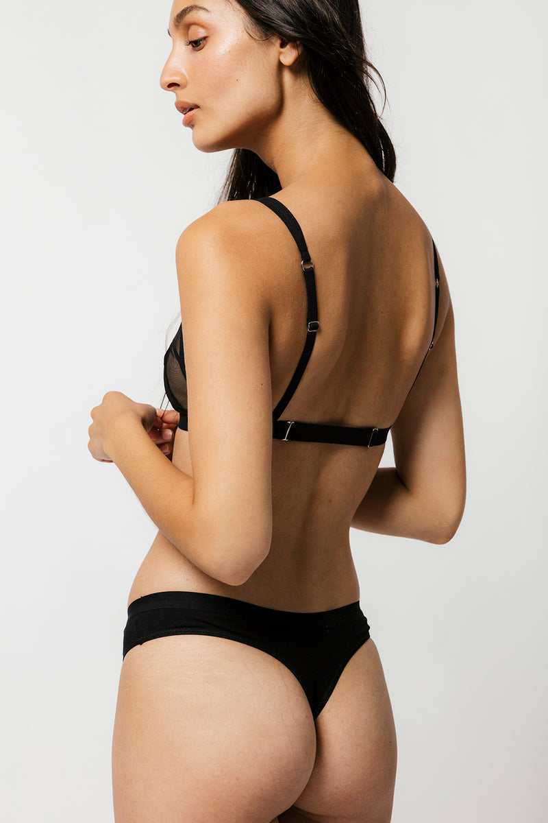 Model showing adjustable bra band and black thong